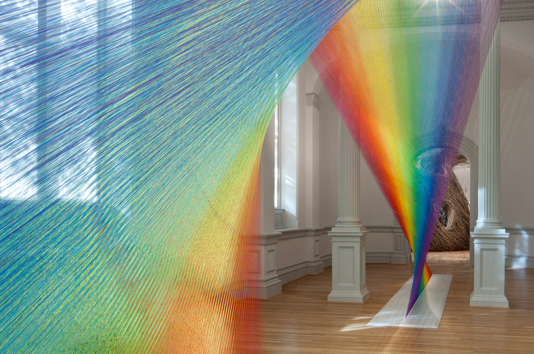 miles of thread and a giant needle weave indoor rainbows creators