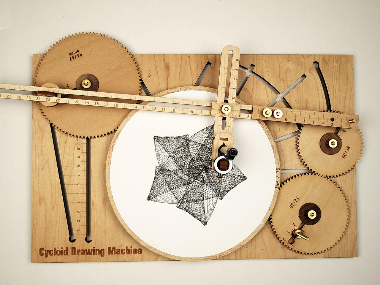 Sketch Intricate Designs with A Hand-Cranked Drawing Machine