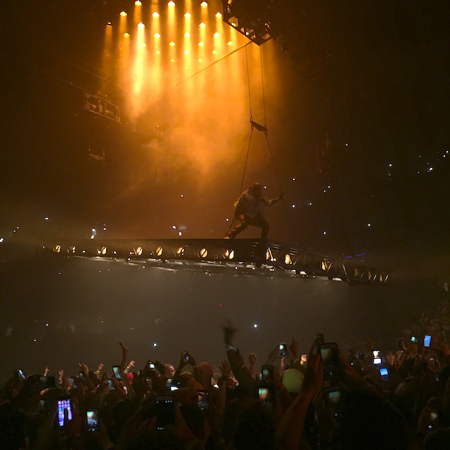 As Mentioned Above For The Duration Of Show Kanye Is Suspended Crowd On Floor Two Stages In Order To Get From One Stage Another
